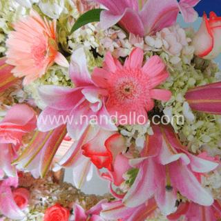 Corona fúnebre rosada