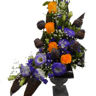 Arreglo de flores y frutas para hombre