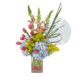 Arreglo con tulipanes en base de vidrio
