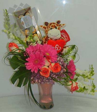 Arreglo floral con peluche